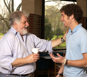 Salvatore Primeggia '64, M.A. '66 talks with a student on campus