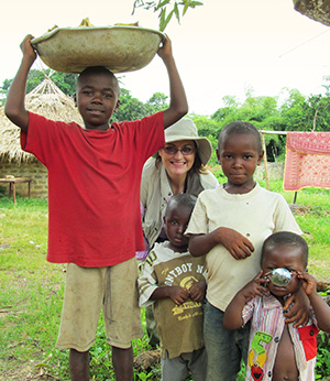 Dr.-B.-with-child-survivors-in-the-Ivory-Coast