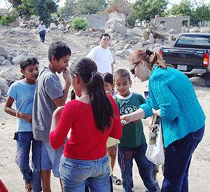 Dr. B.-with-children-who-survived-the-El-Salvador-mudslide.