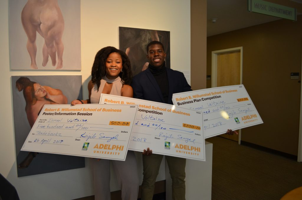 Winners of Adelphi University's first Business Plan Competition holding large checks