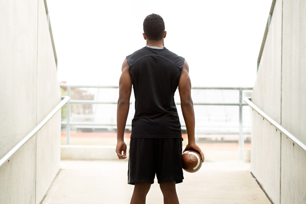 A football player looks out onto the field