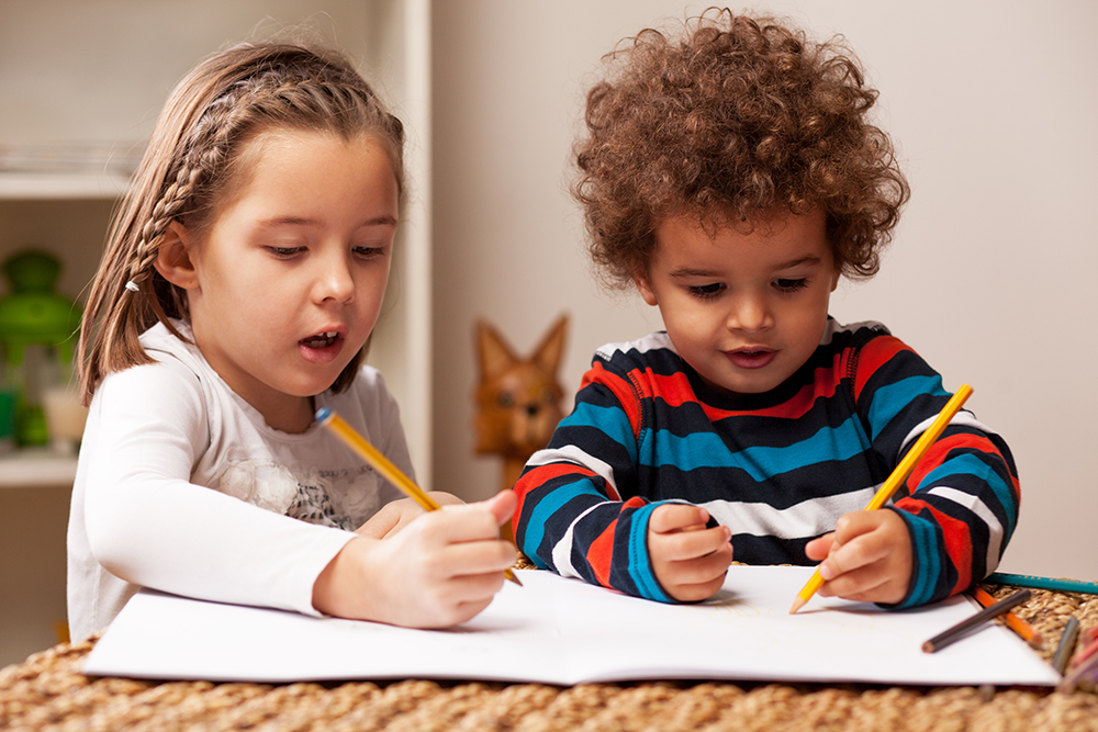 Young kids coloring together