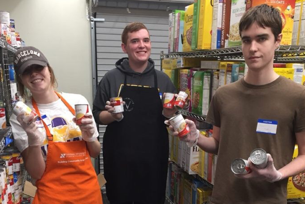Students volunteering at a food pantry
