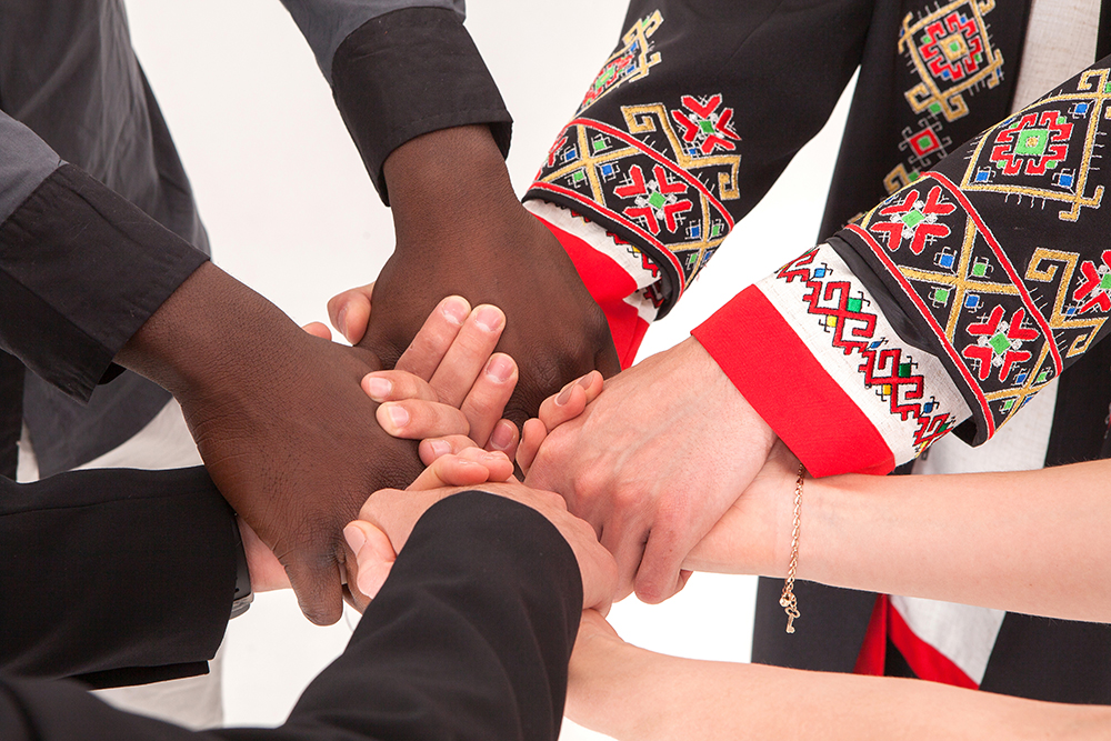 Hands of people from different cultures together