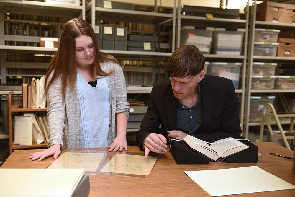 Nicole Quirke looking at old documents