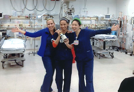 Jennifer Whalen '09 (left) and her coworkers celebrating New Years Eve with apple cider in the Elmhurst Hospital Emergency Department