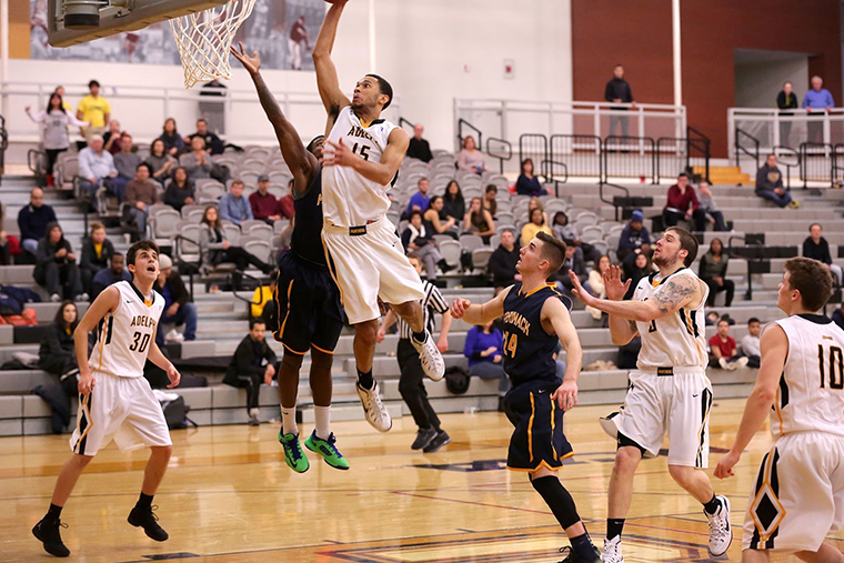Duane Morgan playing basketball for Adelphi University.