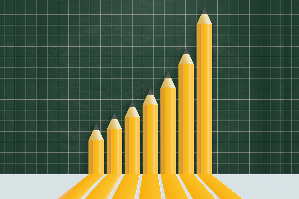 Bar graph implying growth over time, illustrated with pencils.