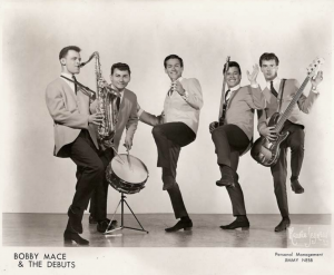 Dr. Mendelsohn with his bandmates in Bobby Mace and the Debuts
