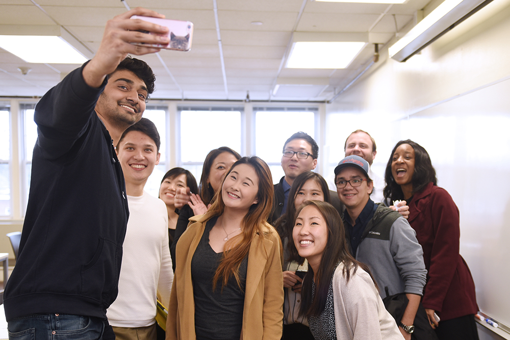 A group of students takes a selfie together