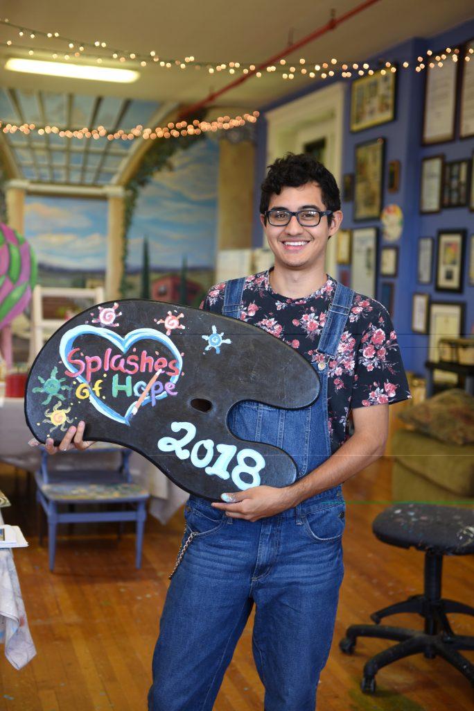 Miguel Guerra with his artwork