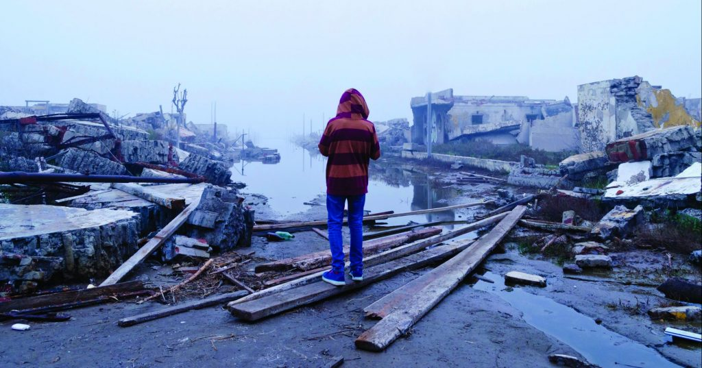 Boy standing in front of pollution